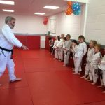 BJJ for Kids - the kids lineup at the start of their BJJ lesson